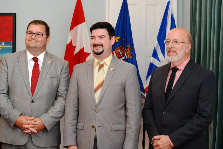 From left, Bernard Davis, Christopher Mitchelmore and Perry Trimper at Government House in St. John's after a swearing-in ceremony Friday, after Premier Dwight Ball shuffled his cabinet.