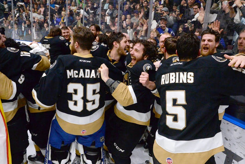 Members of the Newfoundland Growlers celebrate after winning the Kelly Cup at Mile One Centre.