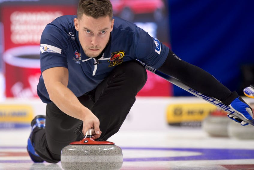 Michael Burns/Curling Canada — Team Gushue second Brett Gallant concentrates on making a throw during play at the Tim Hortons Roar of the Rings Olympic Curling Trials, being held this week in Ottawa.