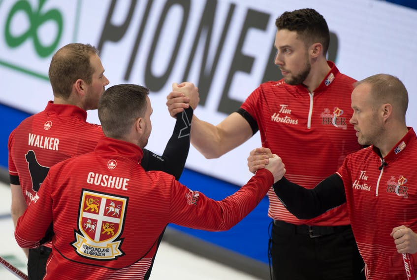 Brad Gushue and Newfoundland and Labrador teammates Geoff Walker (left), Mark Nichols (right) and Brett Gallant (second from right) congratulate each other after a 7-4 win over defending Canadian men's curling champion Kevin Koe and Team Canada in the opening draw of championship-pool play at the Tim Horton's Brier in Kingston, Ont., on Thursday. The Gushue rink lost its second game Thursday, falling 8-4 to Ontario's John Epping. That leaves the Newfoundland rink with a 7-2 record heading into games against Mike McEwen and his Wild Card Entry and Saskatchewan.