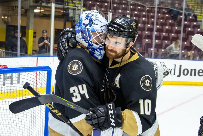 Zach O'Brien, shown here with teammate and Growlers goalie Michael Garteig, has scored a goal in each of his last six playoff games, including a hat trick in the series-clinching 5-1 win over the Manchester Monarchs Monday night. O'Brien is third in ECHL playoff scoring with 10 goals and 18 points.