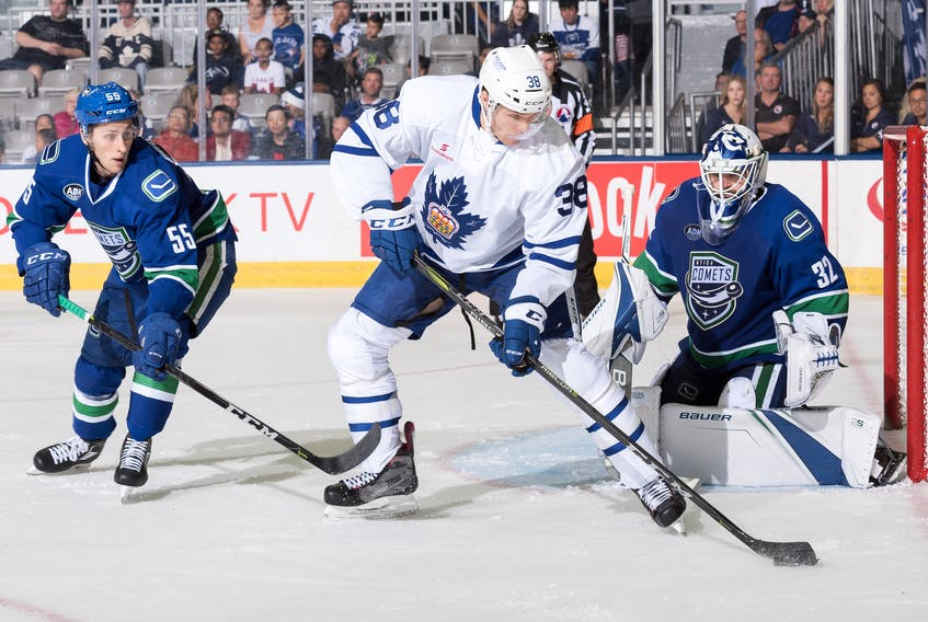 Colin Greening (38), shown in action for the Toronto Marlies in their season-opening game against the Utica Comets, now has seniority among Newfoundlanders playing in the pro ranks.