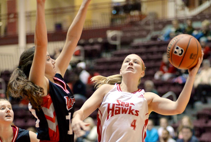 The Memorial Sea-Hawks' Jane Baird (4) goes up for a shot against Jessica Dyck of the Winnipeg Wesmen during their game in the Marie's Mini Mart Fall Classic Saturday afternoon at the MUN Field House.