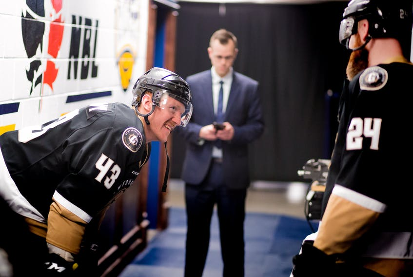 Newfoundland Growlers captain James Melindy talks with fellow defenceman Alex Gudbranson (24) outside the dressing room prior to stepping onto the ice for an ECHL playoffs game at Mile One Centre. — Newfoundland Growlers photo/Jeff Parsons
