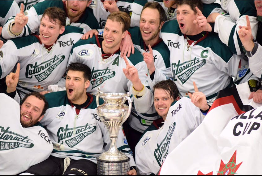 In this April 15, 2017 file photo, members of the Grand Falls-Windsor Cataracts celebrating after winning the Allan Cup national senior men's hockey championship in Bouctouche, N.B. The Cataracts are back with a stiong roster as they prepare to begin a new Central West Senior Hockey League schedule next month, but are dealing with the loss of three significant players (from left), defenceman Luke Gallant (above trophy, with A on his jersey), forward Colin Circelli and captain Michael Brent.