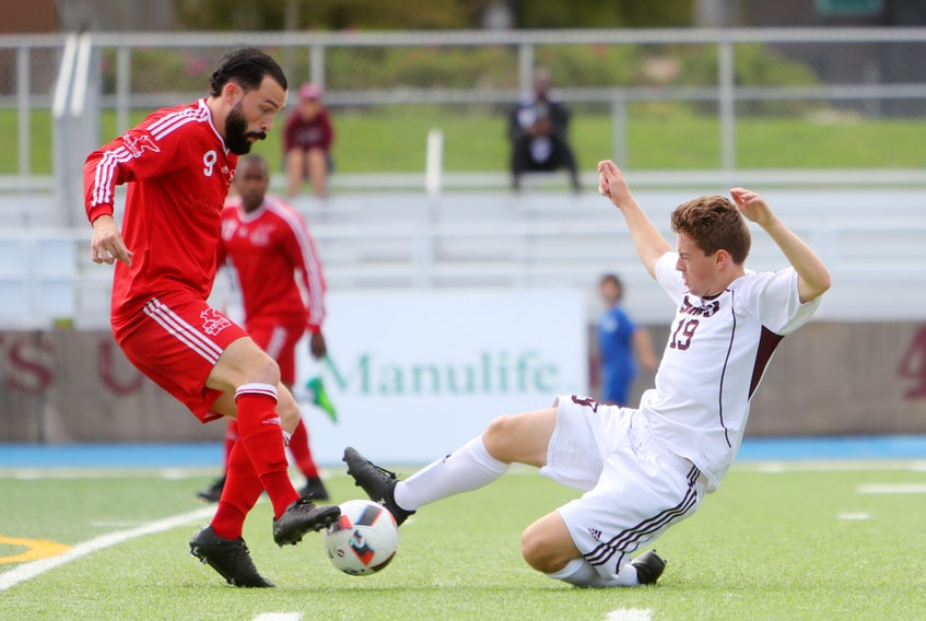 File photo/Saint Mary's University Athletics — In this Sept. 16, 2017 file photo, Tyler Forsey (left) of the Memorial Sea-Hawks is shown in action against the Saint Mary's Huskies during an AUS men's soccer game in Halifax. The Sea-Hawks still haven't guaranteed themselves a playoff spot heading into the final weekend of the 2017 regular season, so they'll be counting on scoring from the likes of Forsey, who leads Memorial in goals, as they face the visiting Université de Moncton Aigles Bleus at King George V Park Friday and Saturday.