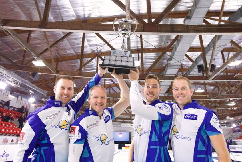 From left, Brad Gushue, Nark Nichols, Brett Gallant and Geoff Walker hoist the championship trophy after winning The Masters Grand Slam of Curling event Sunday in Lloydminster, Sask.