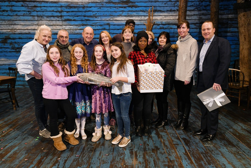 """The Anne Hutchinson School in Eastchester, N.Y., made cards for families who lost loved ones on 9-11.  In addition, the children each donated $1 to the charity Broadway Cares. Pictured along with members of the """"Come From Away"""" cast are school principal Annette Keane, student council moderators Bobbi Iacovelli and Felicia Maldari, Nick Katsoris and several of the Sweet Treat Girls (Siena Versaci, Julia Katsoris, Caitlin Savitt and Taylor Naclerio). They presented cards to the cast from their school and sent to families at the 9-11 Tribute Museum. The girls also presented a cheque for $1,103 from the money raised.  It was a way to say thanks to all the people of Gander for showing New Yorkers the true meaning of kindness and for inspiring the Loukoumi Make A Difference Foundation to embark on this project with """"Come From Away."""""""