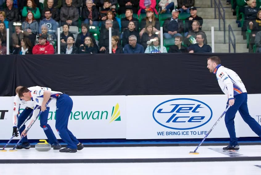 Brad Gushue follows his shot down the ice as his sweepers go to work on the rock during play in the Humpty's Champions Cup quarter-final against Kevin Koe Saturday in Saskatoon, Sask.