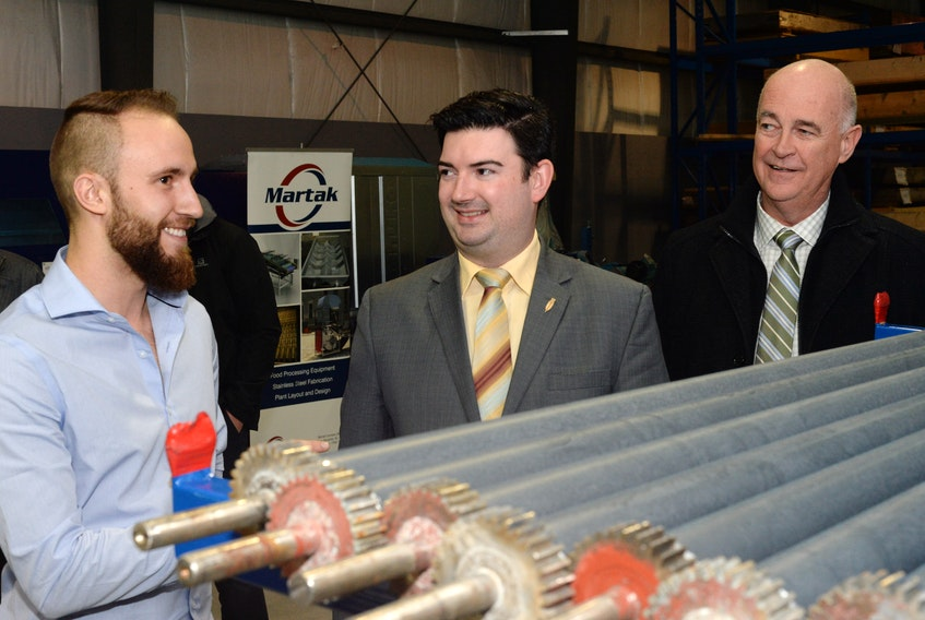Tourism, Culture, Industry and Innovation Minister Christopher Mitchelmore (centre) and Avalon MP Ken McDonald (right) visited the Martak Canada Ltd. facility on McNamara Drive in Paradise Wednesday afternoon.