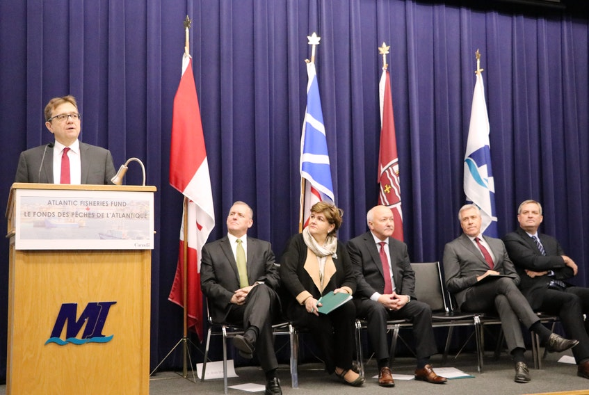 Jonathan Wilkinson, federal minister of Fisheries, Oceans and the Canadian Coast Guard, announces more than $18 million for projects through the Atlantic Fisheries Fund Wednesday in St. John's. Seated (from left) are Rob Shea, associate vice-president of the Marine Institute; Gudie Hutchings, Long Range Mountains MP; Churence Rogers, Bonavista-Burin-Trinity MP; Premier Dwight Ball; and Minister of Fisheries and Land Resources Gerry Byrne.