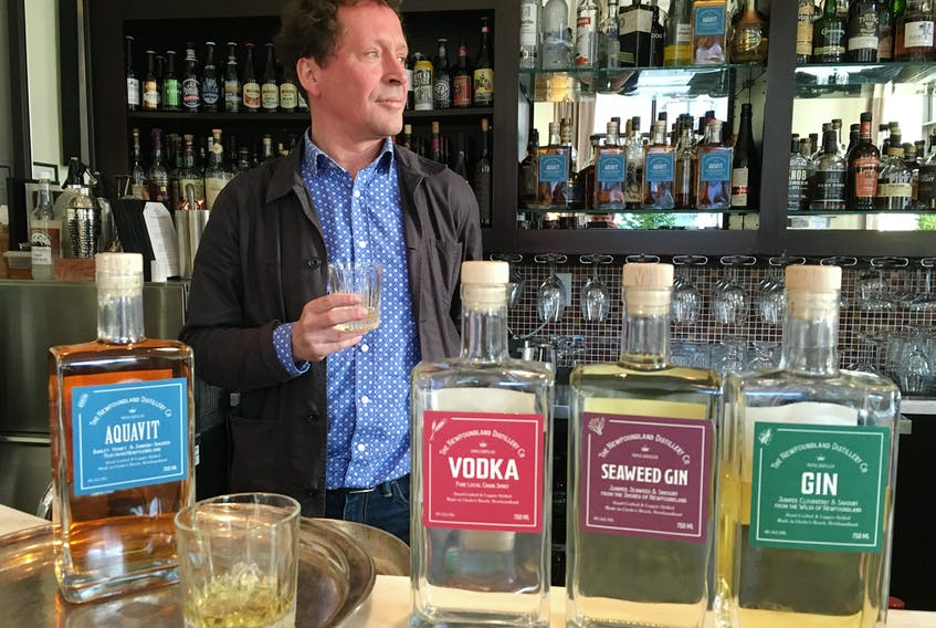 Newfoundland Distillery Co. co-owner Peter Wilkins enjoys a taste of aquavit, the company's fourth product to be launched this year.