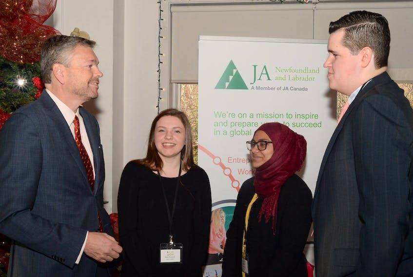 Mark Dobbin chats with Junior Achievers Maria Downton, Rohya Ahmad and Riley Shea.