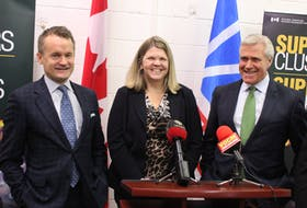 (From left) Federal cabinet minister Seamus O'Regan, Supercluster CEO Kendra MacDonald and Premier Dwight Ball prepare to take questions from reporters in St. John's on Friday following an announcement on the Ocean Supercluster.