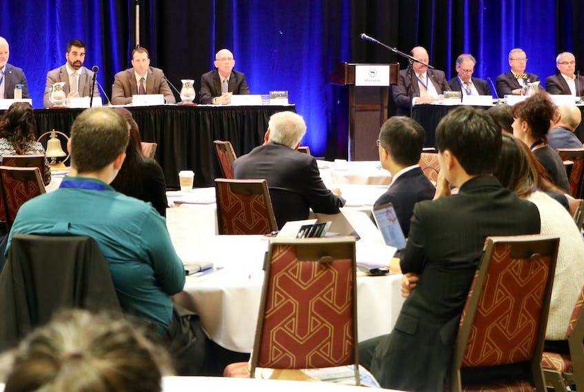 Delegates at a St. John's conference listen to a panel discussion on subjects relating to vessel navigation in the Canadian Arctic.