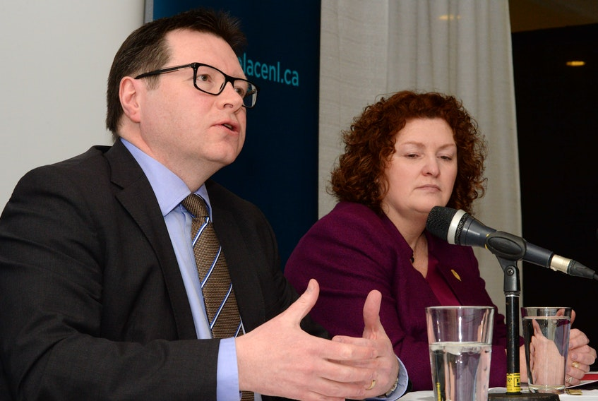 Workplace NL chief executive officer (CEO) Dennis Hogan and Service NL Minister Sherry Gambin-Walsh speak at a news conference at the Workplace NL offices on Forest Road on Tuesday.
