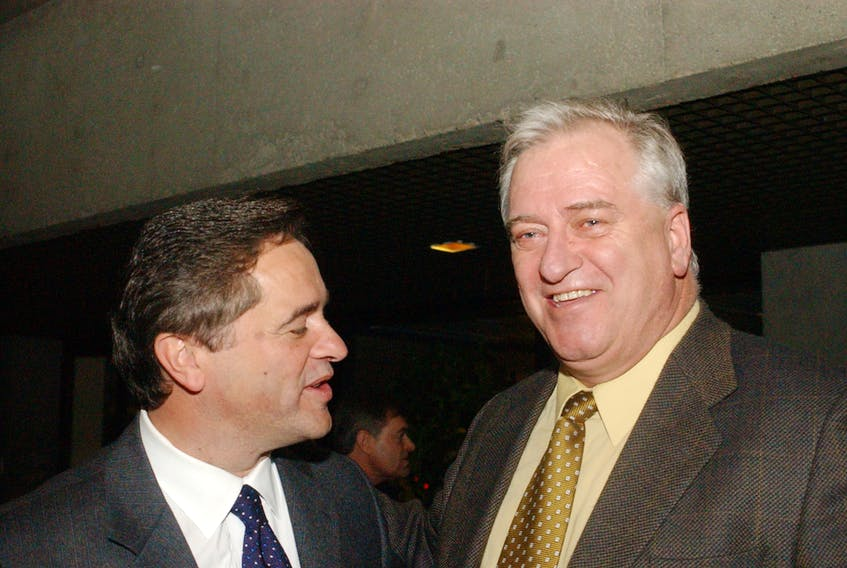 In this January 2002 photo, former federal Industry Minister Brian Tobin (left) chats with Beaton Tulk, Newfoundland and Labrador's then Minister of Development and Rural Renewal in St. John's following Tobin's announcement of his resignation from federal politics for the second time. Tulk, who succeeded Tobin as premier of Newfoundland and Labrador in October 2000, died Thursday. He was 75. — Telegram file photo