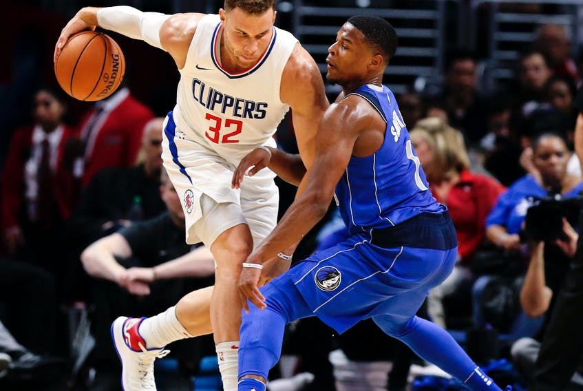 Blake Griffin of the Los Angeles Clippers takes the ball to Dallas Mavericks rookie guard Dennis Smith Jr. during a recent NBA game. Smith Jr. played at NC State last year, where current St. John's Edge coach Jeff Dunlap was the director of basketball operations.