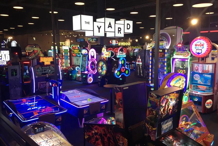 The gaming area at Cineplex's Rec Room in the Avalon Mall is known as The Yard and contains dozens of classic and modern arcade games, all accessed using reloadable radio frequency identification wristbands instead of coins or bills.