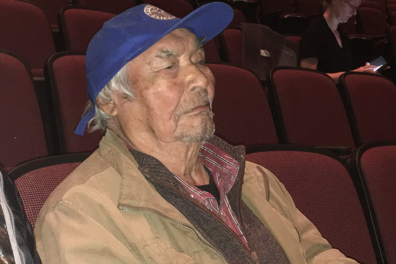 Innu elder Sebastian Penunsi awaits his call to the witness stand at the Muskrat Falls Inquiry, waiting in the seats of the Lawrence O'Brien Arts Centre in Happy Valley-Goose Bay. Penunsi was born in Labrador in 1930 and spoke to the history of use of the area of the lower Churchill River, the area of the Muskrat Falls hydro project. - Ashley Fitzpatrick