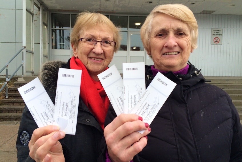 """St. John's residents — and sisters — Agnes Duke (left) and Mary McGrath, celebrate their purchase of tickets to attend a performance of """"Come From Away"""" which opens Wednesday in St. John's at Holy Heart Theatre. The sisters purchased the tickets at the Holy Heart Theatre box office when it opened just after 10 a.m. this morning (Tuesday). They arrived at the box just before 6 a.m. to wait in line for their tickets for the opening matinee show at 1:30 p.m. on Wednesday afternoon. There are a total of eight shows running from Wednesday through Sunday (1:30 p.m. and 7:30 p.m. ) The theatre, which holds 976 fixed seats and 24 wheel chair zone seats (12 users/12 attendants). A spokesperson at the theatre said she expects all eight shows to be full with 1,000 per show seated."""