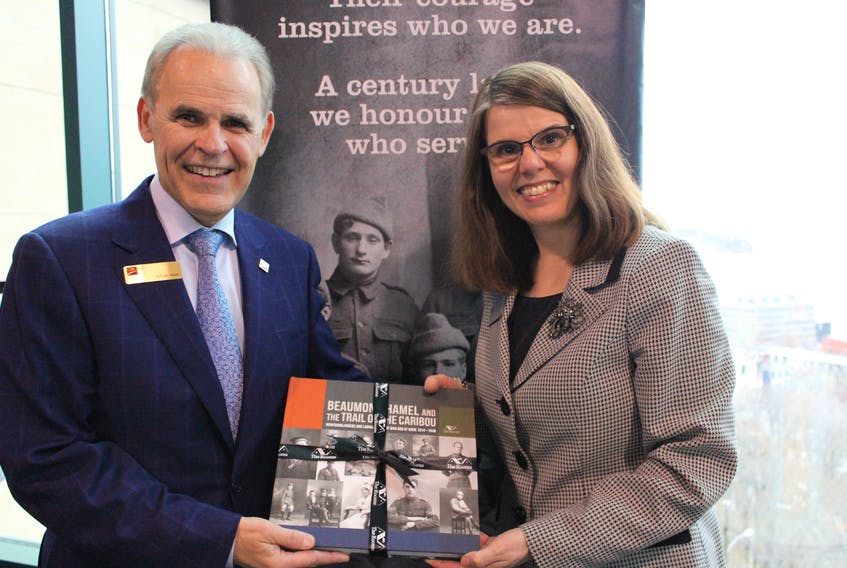 """CIBC senior vice-president and Eastern Canada region head Sylvain Vinet (left) and The Rooms director Anne Chafe at the Monday evening launch of the companion catalogue for the exhibition of the same name, """"Beaumont-Hamel and the Trail of the Caribou."""""""