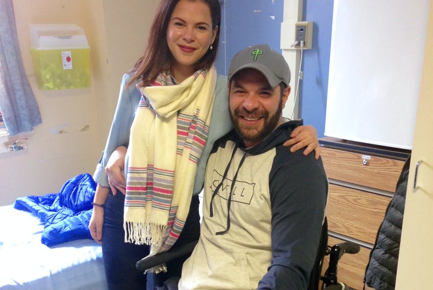 Geordie Horan and his girlfriend Dayna Humphries pose for a photo in Horan's room at the Dr. Leonard A. Miller Centre in St. John's Wednesday. Two months ago, Horan suffered a workplace injury that left him partially paralyzed.