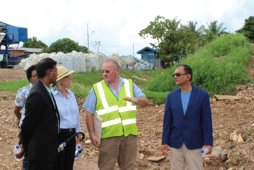 WTS president Glen Sharp (second from right) is accompanied by Shamshad Mohammed, chairman of the Trinidad and Tobago Solid Waste Management Co. Ltd., as he explains how the company's landfill leachate pilot project works to Carla Hogan Rufelds, Canadian high commissioner to the Caribbean country.