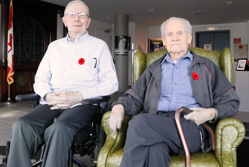 Veterans James Samuel Miller, 81, (left) and James Kirby, 94, discuss their thoughts on Remembrance Day at the Caribou Memorial Veterans Pavilion in St. John's Friday.