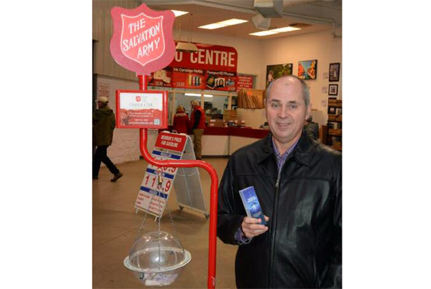 Salvation Army volunteer Larry Wiseman mans the Christmas kettle at Costco on Stavanger Drive in St. John's on Monday morning, carrying on his later father's tradition.
