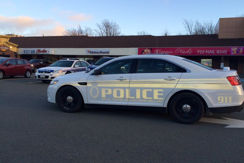 Two of the RNC vehicles of several that responded to an incident in a Kenmount Road strip mall near the Columbus Drive exit in St. John's. — Joe Gibbons/The Telegram