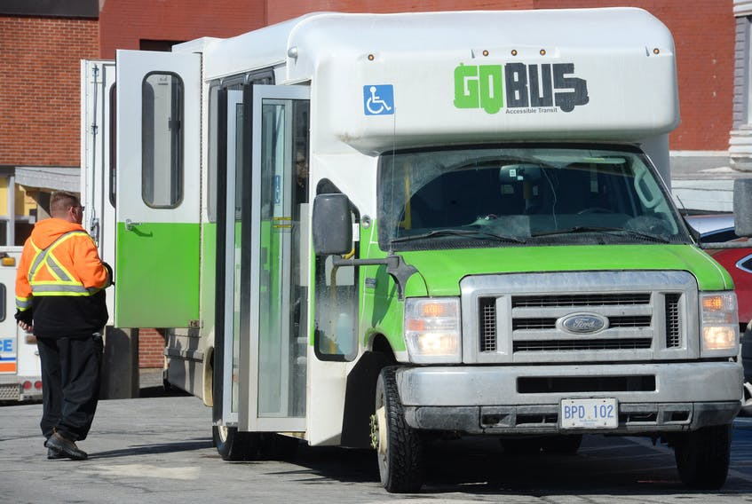 A GoBus collects passengers from the Leonard A. Miller Centre on Forest Road in St. John's.