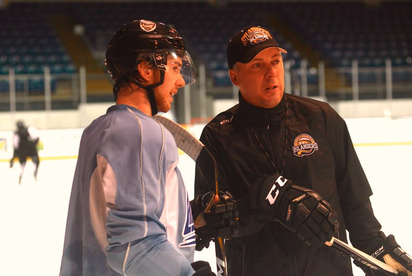 Charlottetown Islanders head coach Jim Hulton speaks with assistant captain Keith Getson at the end of Wednesday's practice.
