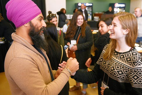 Federal NDP leader Jagmeet Singh chats with NDP P.E.I. member Kari Kruse during a meet and greet at the provincial party's leadership convention in Murphy's Community Centre on Saturday. Kruse said she was impressed by Singh, who advocated for a number of social justice issues while in the province.  ©THE GUARDIAN