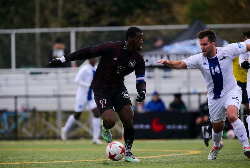 Holland College Hurricanes striker Ibra Sanoh, left, looks for a teammate during Wednesday's action against the Keyano Huskies at the Canadian Collegiate Athletic Association men's soccer championship.