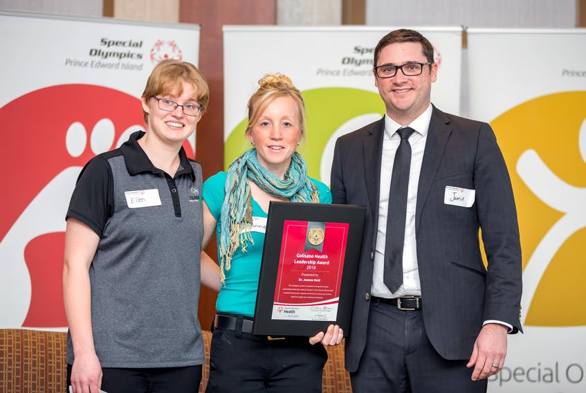 Dr. Joanne Reid, centre, receives the Golisano Health Leadership Award from Special Olympics Canada's 2018 female athlete of the year Ellen MacNearney, left, and Jamie Arsenault, Special Olympics P.E.I.'s president at a luncheon in Charlottetown.