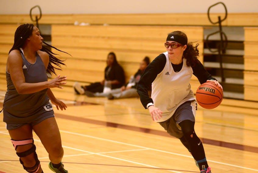 Breauna Rivoli-Johnson, right, drives on Jayla Verney during Tuesday's Holland College Hurricanes basketball practice. Jason Malloy/The Guardian