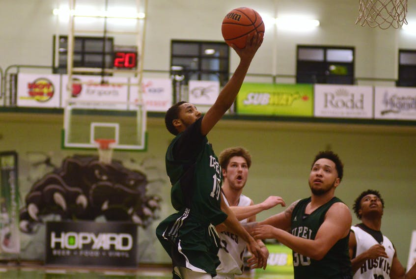 UPEI Panthers point guard Amin Suleman goes to the rim Saturday against the Saint Mary's Huskies.