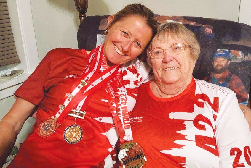 Warrant Officer Charlene Arsenault is congratulated by her mother, Evelyn Arsenault of Tignish, after winning a Canadian Armed Forces national military marathon. (Submitted photo)