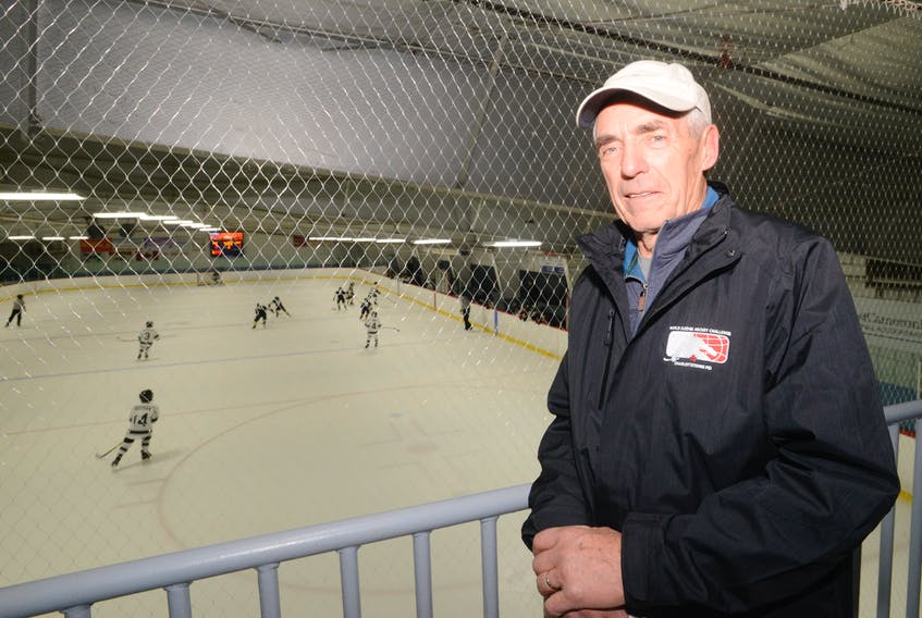 Bryon Sutcliffe enjoys watching the action at the Cody Banks Arena Thursday as the 40th anniversary of the Early Bird hockey tournament began. Jason Malloy/The Guardian