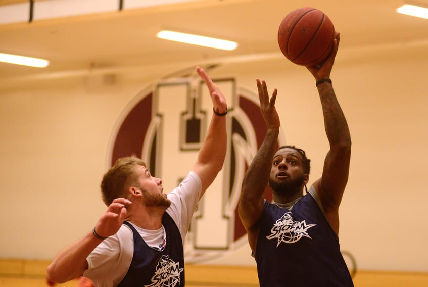 Torrence Dyck, right, takes a shot over Wayne McCullogh during Island Storm practice Tuesday at Holland College. Jason Malloy/The Guardian