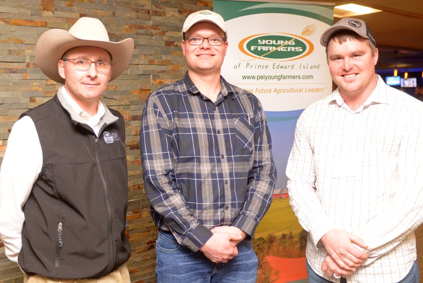 P.E.I. Young Farmers of Canada second vice-president, from right, Mark Verleun and president Ian Drake chat with keynote speaker Don Schiefelbein during the organization's annual general meeting at Murphy's Community Centre on Saturday. Schiefelbein, president of major Angus producer Schiefelbein Farms in Minnesota, spoke on the importance of being innovative in the industry. Schiefelbein Farms is a family operation that was started by Schiefelbein's father in 1955 and has grown to become the largest registered Angus cattle producers in Minnesota and about the 20th largest seedstock producer in the U.S.