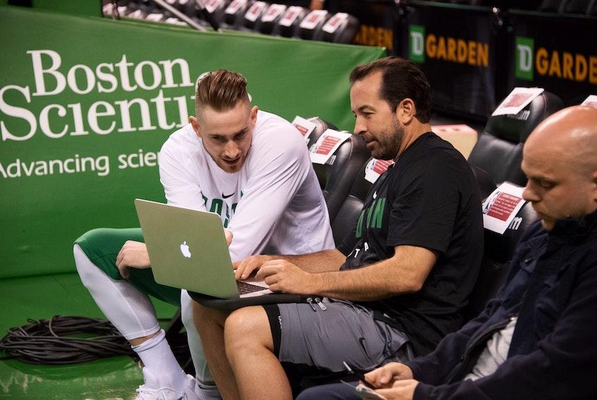 Morell's Scott Morrison, an assistant coach with the Boston Celtics, talks with forward Gordon Hayward, left.