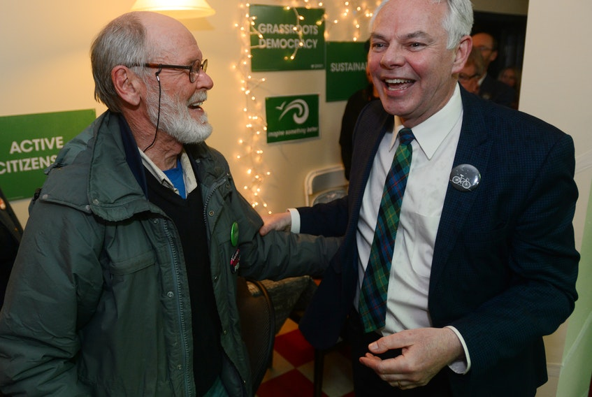 Green leader Peter Bevan-Baker is congratulated by a party supporter after winning re-election Tuesday. The Greens formed the official opposition with eight seats.