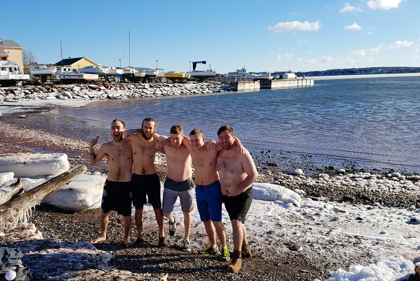 The cold weather isn't enough to stop some people from taking a dip. John Stokes, left, Nathan Trainor, Scott Callaghan, Brett Beaton and Alan Trainor took the plunge at the Charlottetown Harbour on Dec. 26.