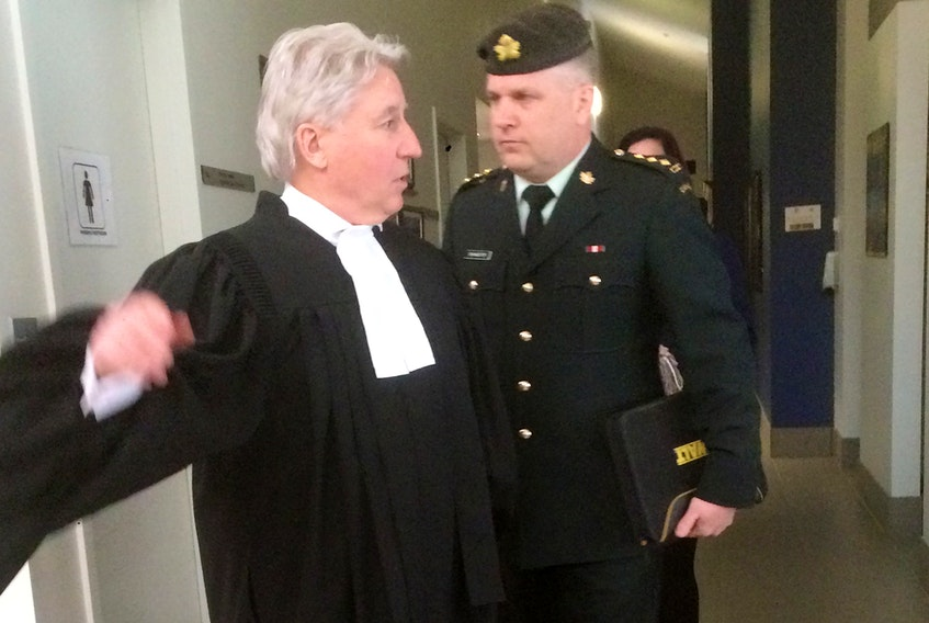 Army reserve captain Todd Bannister and his defence lawyer J.L.P.L. Boutin leave a court martial in Charlottetown on Tuesday. Bannister was found not guilty on two counts of behaving in a disgraceful manner and two counts of conduct to the prejudice of good order and discipline.