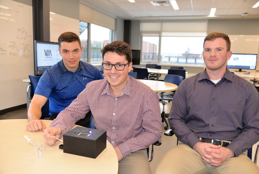UPEI engineering students Mason Boertien, left, Bryce Stewart and Robert Smith have designed and developed a prototype of a THC breathalyzer.
