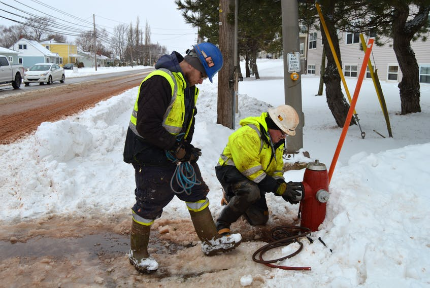 Crew members with Charlottetown's Water and Sewer Utility work on a fire hydrant at the corner of North River Road and Belvedere Avenue on Thursday morning in relation to a water main break at the intersection.