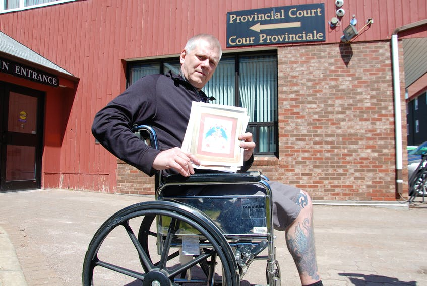 Donald (Artie) Gautreau, owner/operator of Extreme Ink, shows a drawing he did as a thank you to staff at the QEH in Charlottetown. Gautreau received a conditional discharge Wednesday for his part in a violent altercation Dec. 23 that resulted in part of his leg being amputated.