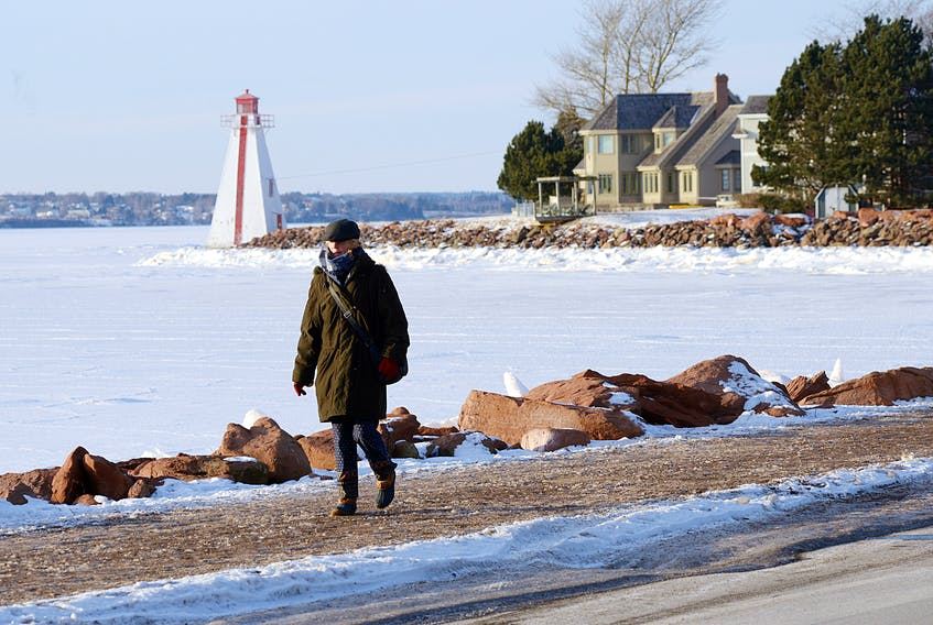 Michelle Trainor of Charlottetown gets in her daily walk around Victoria Park in Charlottetown on Wednesday. Islanders are bracing for a major winter storm to begin pounding the province Thursday afternoon. Strong winds and heavy precipitation is forecast to last into Friday.